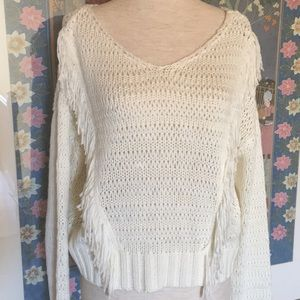 Cream colored sweater with fringe